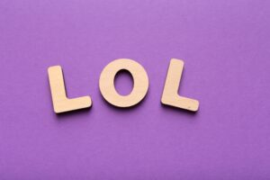 LOL abbreviation spelled with wooden letters